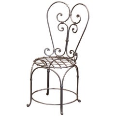 19th Century French Louis XV Polished Iron Armchair