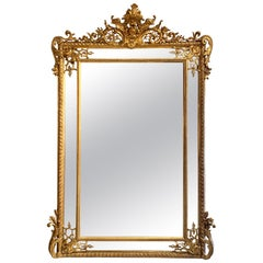19th Century French Louis XV Style Carved and Giltwood Mirror