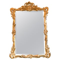 19th Century French Louis XV Style Carved and Parcel Gilt Mirror
