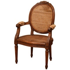 19th Century French Louis XVI Carved Walnut and Cane Child Armchair