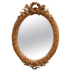 19th Century French Louis XVI Oval Carved Giltwood and Beveled Glass Mirror