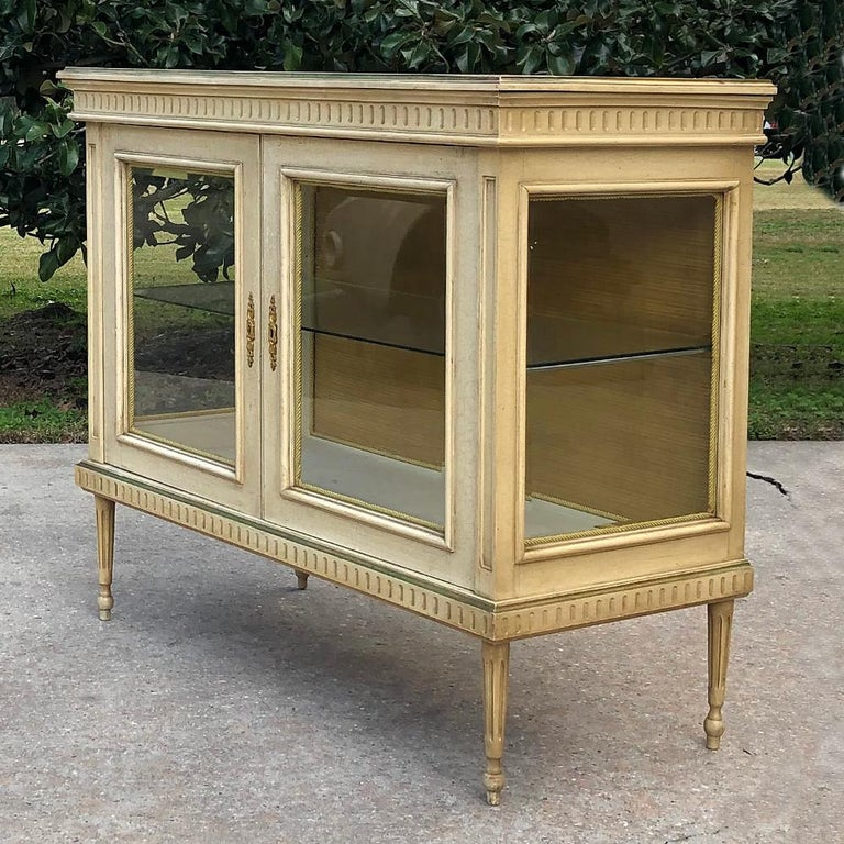 19th century French Louis XVI painted vitrine makes a great case to display your special collection or family heirlooms! Tailored lines in the neoclassic style are enhanced by the painted finish which has achieved a lovely patina. Beveled glass on