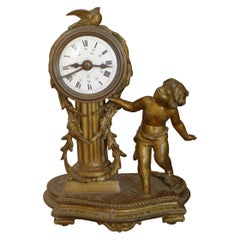 19th Century French Louis XVI Patinated Desk Clock with a Figure of a Boy