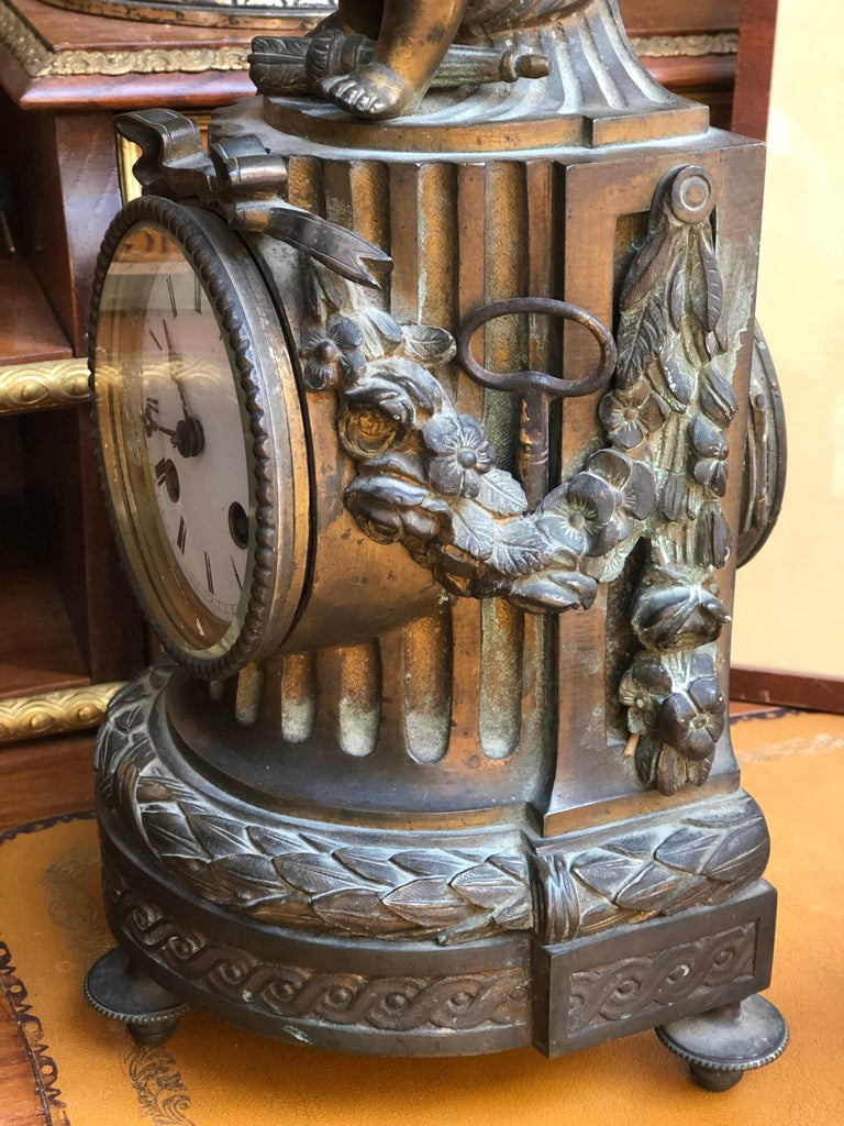 19th Century French Louis XVI Patinated Table Clock with a Figure of a Cupid In Good Condition For Sale In , CH