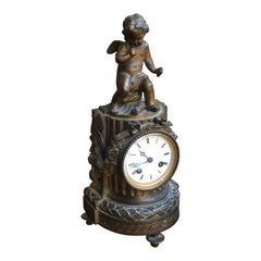 19th Century French Louis XVI Patinated Table Clock with a Figure of a Cupid