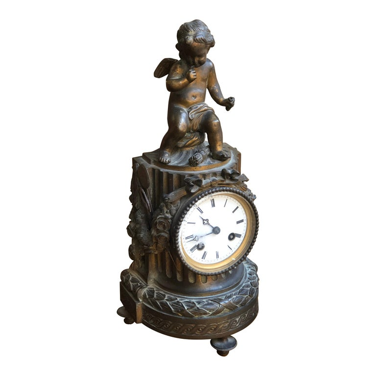 19th Century French Louis XVI Patinated Table Clock with a Figure of a Cupid For Sale