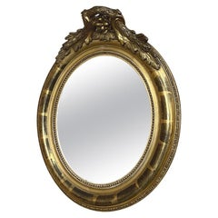 19th Century French Louis XVI Petite Gilded Oval Mirror