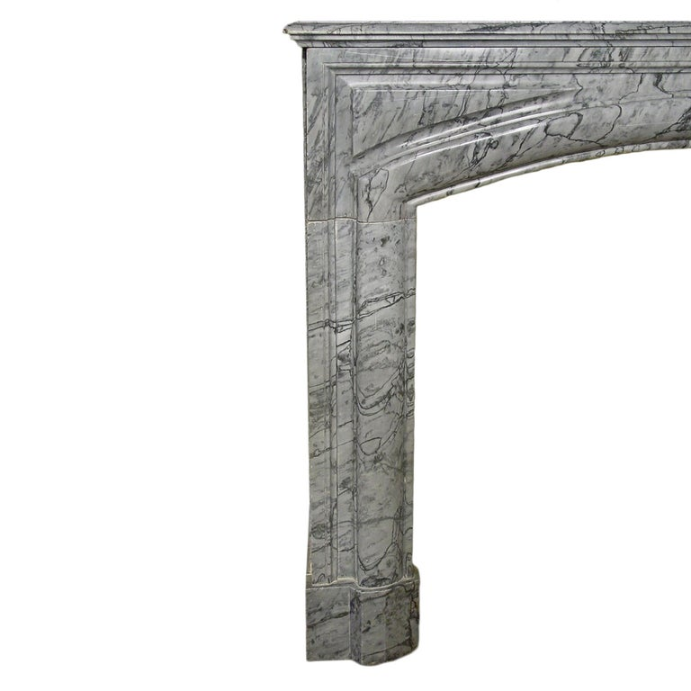 A spectacular and important 19th century French Louis XVI style Gris St. Anne marble mantel. The mantel façade is decorated with a fine rich sculpted curved border. With volute jambs below a thick rectangular moulded shelf.