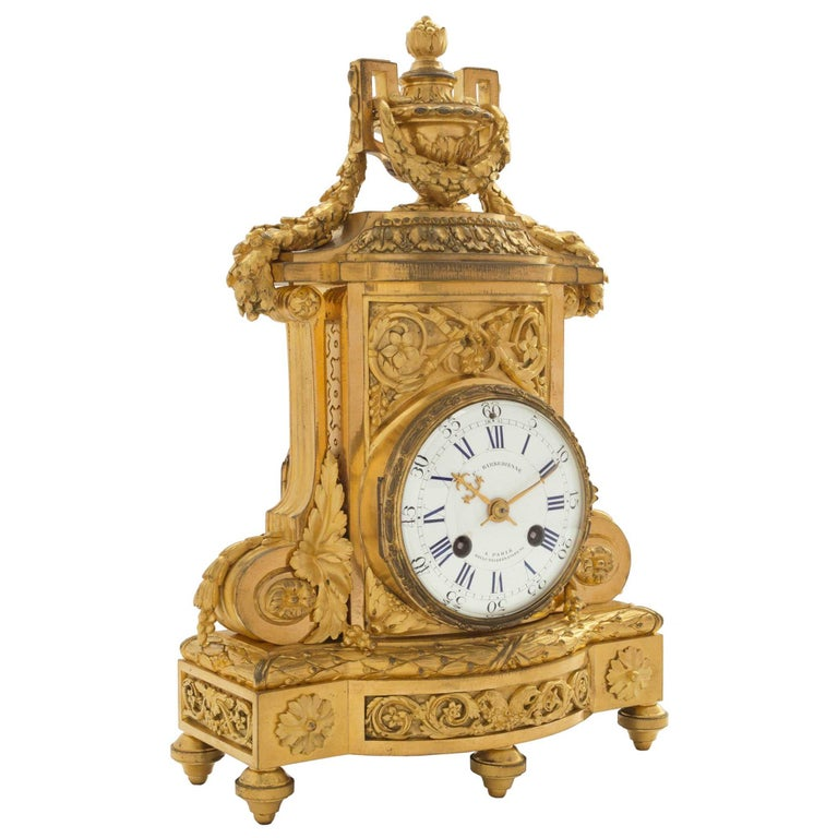A very elegant and richly chased 19th century French Louis XVI st. ormolu clock signed F. Barbedienne. The clock is raised by five toupee shaped feet. At the frieze are two rosettes encompassing a Rinceau design below the berried laurel band. Above