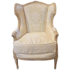 19th Century French Louis XVI Style Carved and White Washed Bergère