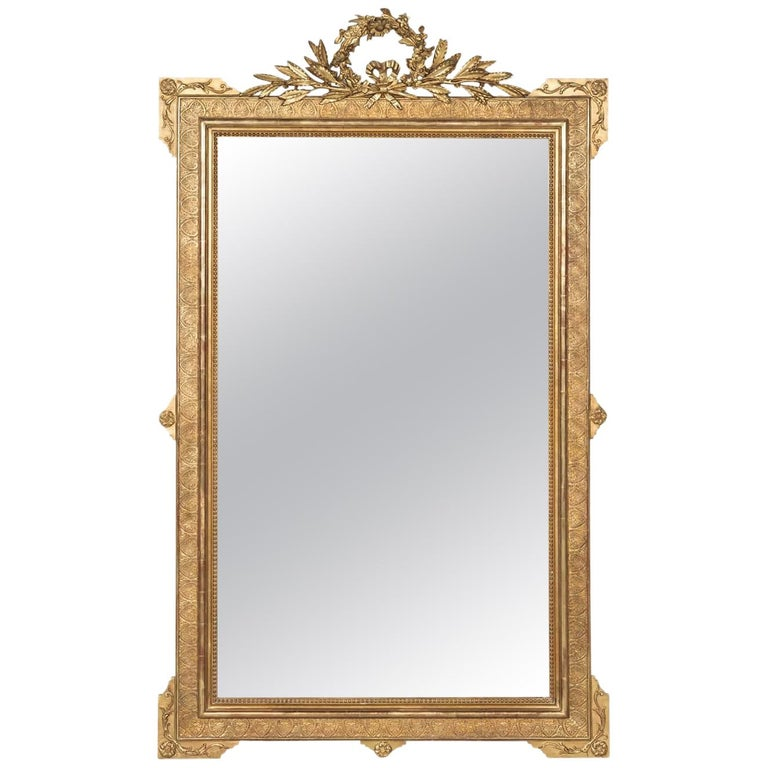 19th Century French Louis XVI Style Carved Giltwood Mirror For Sale