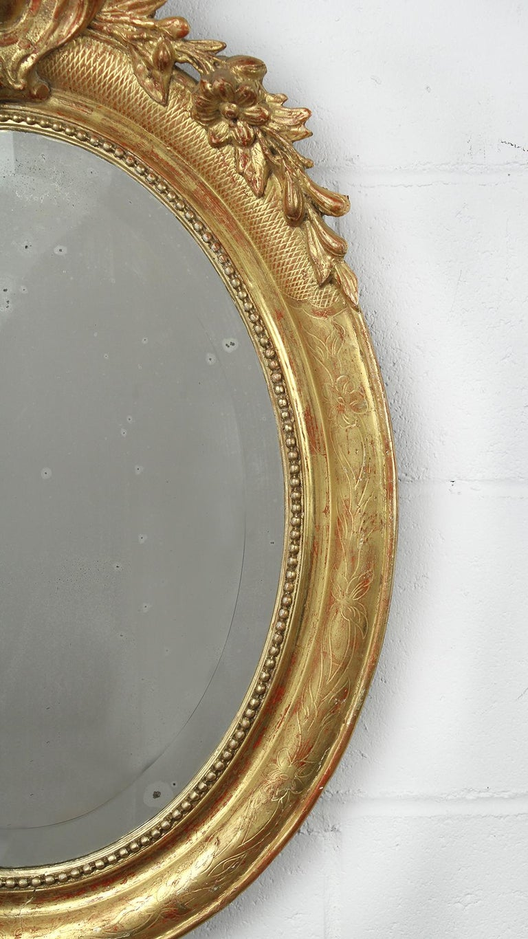 Beveled 19th Century French Louis XVI Style Gilt Oval Mirror For Sale