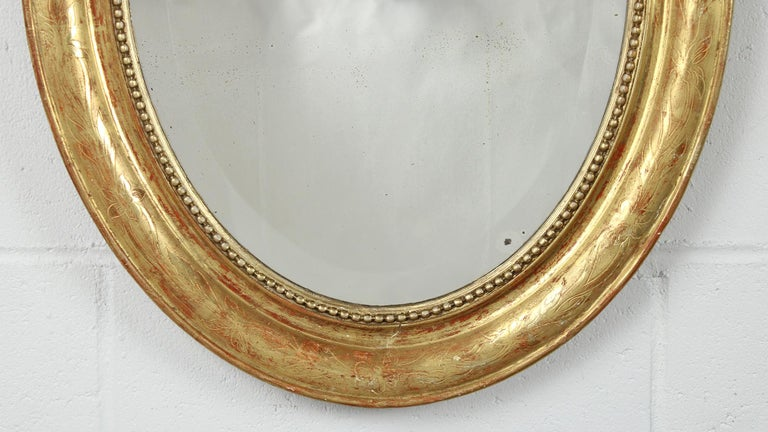19th Century French Louis XVI Style Gilt Oval Mirror In Good Condition For Sale In Los Angeles, CA