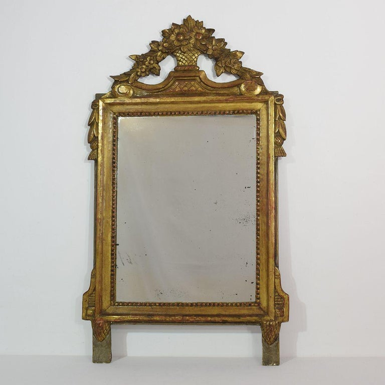 Very nice Louis XVI style giltwood bridal mirror with original mirror glass. France, 19th century. Weathered, losses and old repairs.
