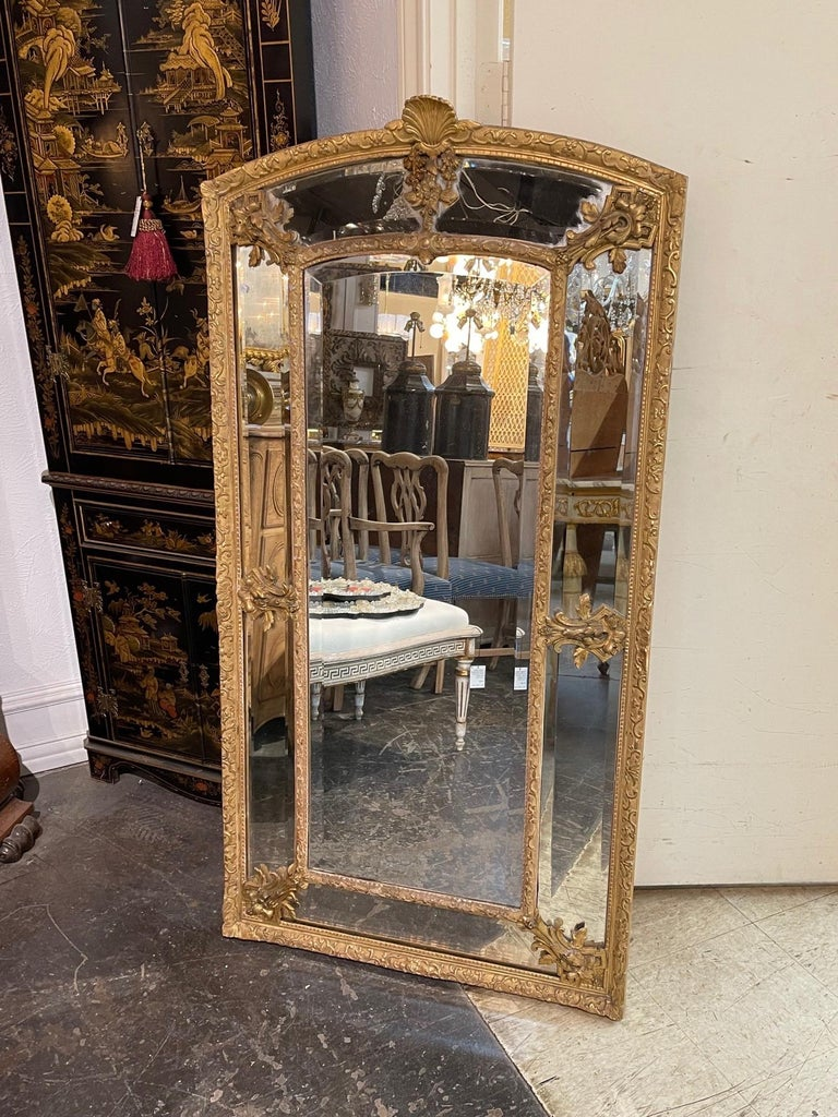 Elegant 19th century French Louis XVI style giltwood cushion mirror with glass panels. Very fine carving including a shell at the top. Stunning!!