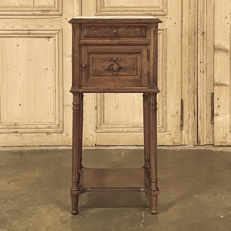 19th century French Louis XVI walnut marble top nightstand is the perfect choice for a bedside companion, or perhaps a seating group as it provides a luxurious marble top for carefree daily use, a convenient drawer, a cabinet, and a lower shelf for