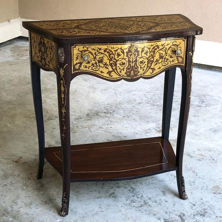 19th Century French Mahogany Intricately Inlaid with Brass Console is an unusual find, indeed!  Exhibiting a subtle expression of the Louis XV - or Rococo - style, it features a gracefully bowed front with serpentine sides, an upper drawer and lower