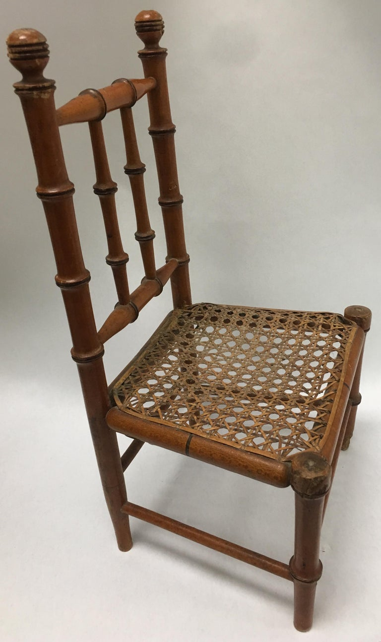 19th century French miniature fruitwood faux bamboo carved wood chair with original caned seat. Seat is 6