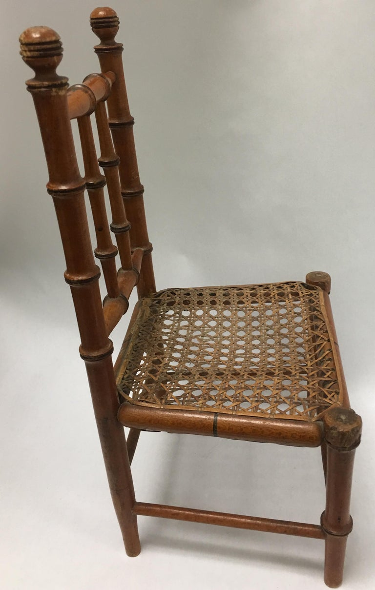 Rustic 19th Century French Miniature Fruitwood Faux Bamboo and Cane Doll Chair For Sale