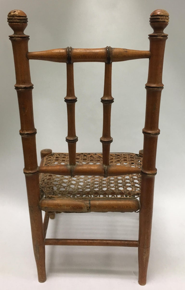 Hand-Carved 19th Century French Miniature Fruitwood Faux Bamboo and Cane Doll Chair For Sale