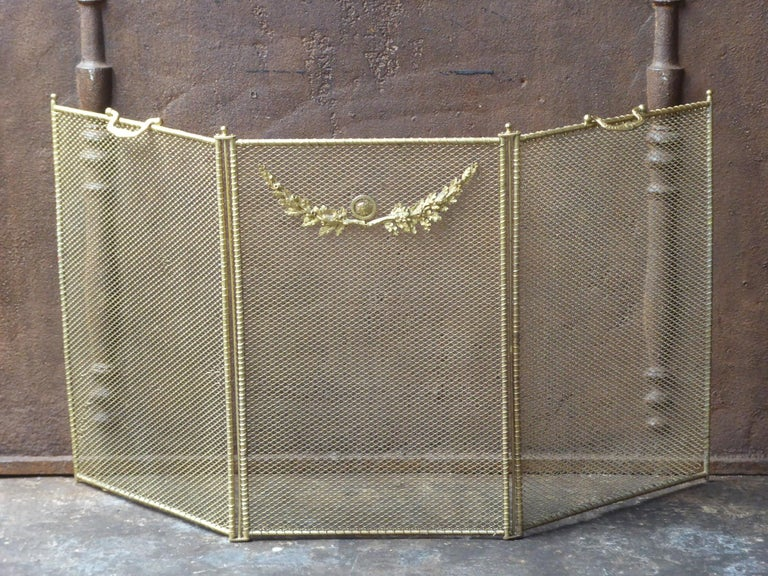 19th century French Napoleon III fireplace screen made of iron and iron mesh.