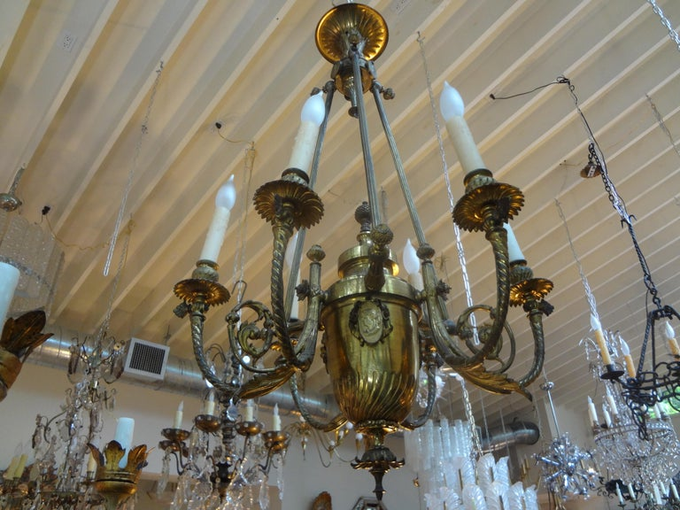 Stunning 19th century French Napoleon III gilt bronze six-light chandelier. This antique French bronze chandelier was originally gas and now electrified for The U.S. Market. This antique chandelier dates to the 1870s.