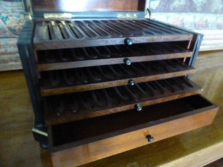 Beautiful 19th century French Napoleon III blackened wooden cigar cellar and ivory marquetry ornamentation. Four drawers for cigars and one drawer for cigar cutters. Very good condition.