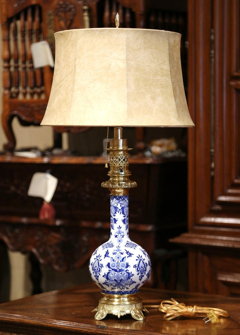 This elegant antique oil lamp was converted into a table lamp. Crafted in France, circa 1880, the tall porcelain