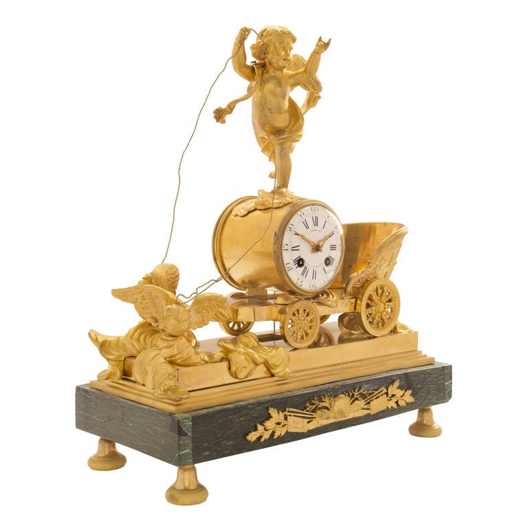 A spectacular mid-19th century French neoclassical Empire style ormolu and marble clock. The clock is raised on a rectangular Vert Maurin marble base with ormolu supports. Centered at the front is an ormolu mount of shells and coral flanked by