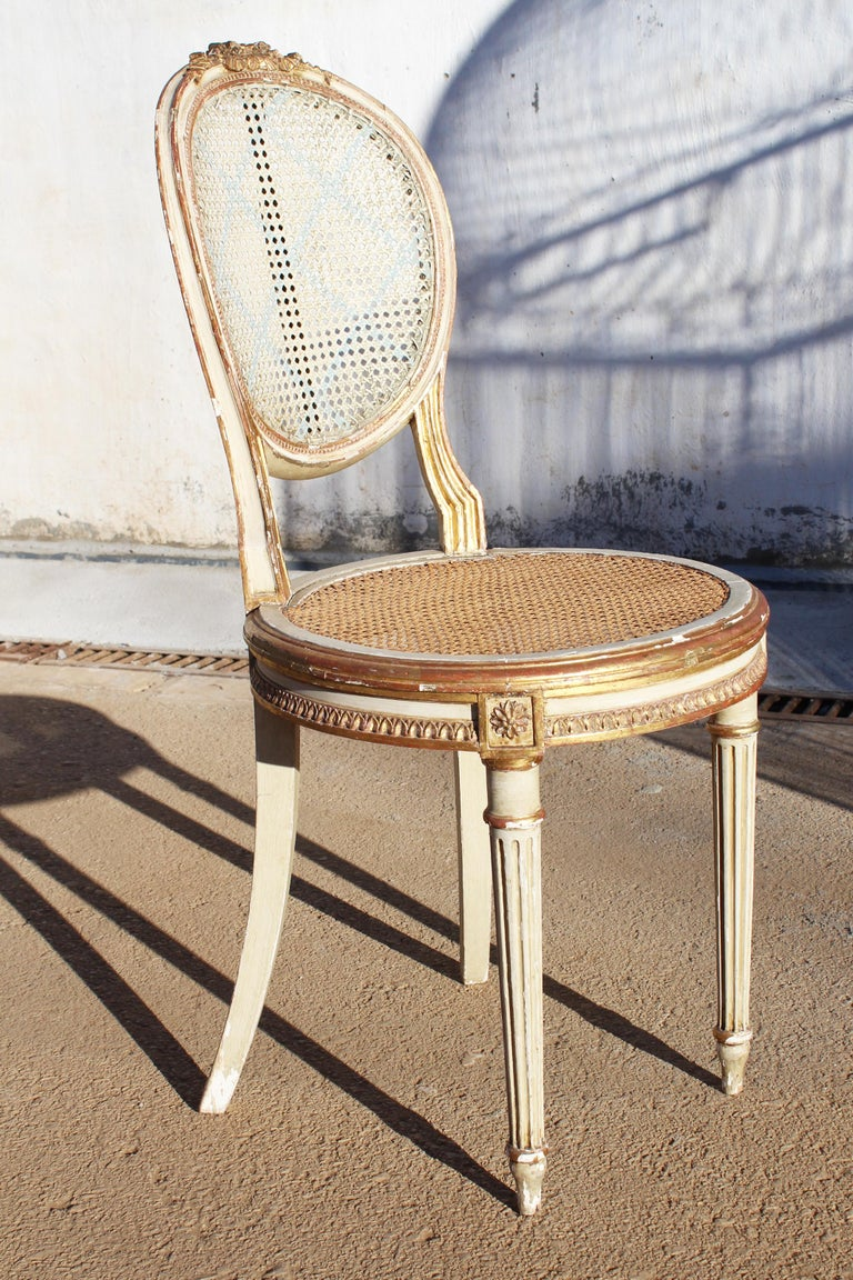 19th century French neoclassical cane back chair, with the rare quality of being slightly smaller than similar period chairs, making it rare and unique.