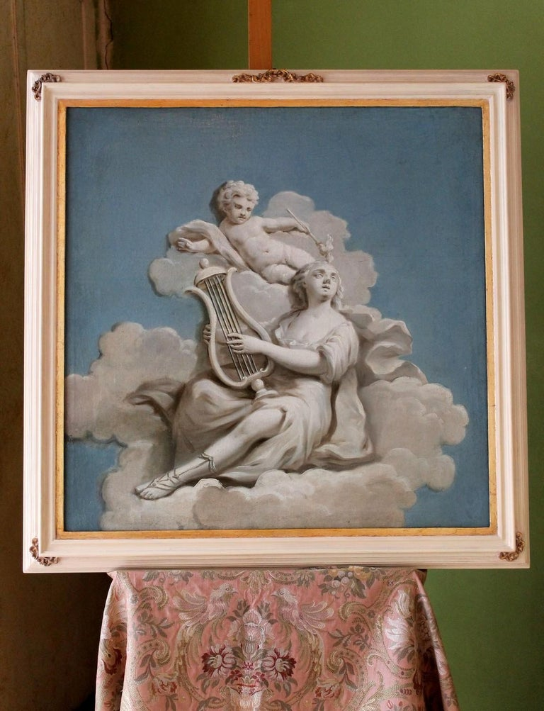 This lovely French 19th century oil painting on square canvas has a sky blue background, a fluffy cloud fills the central part of the painting where a woman is lying down playing the lyre, while a graceful cherub seems to twirl over her. This oil