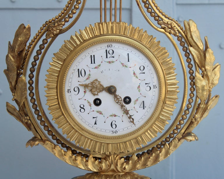 Gilt 19th Century French Ormolu and Marble Three-Piece Lyre Shaped Clock Garniture For Sale