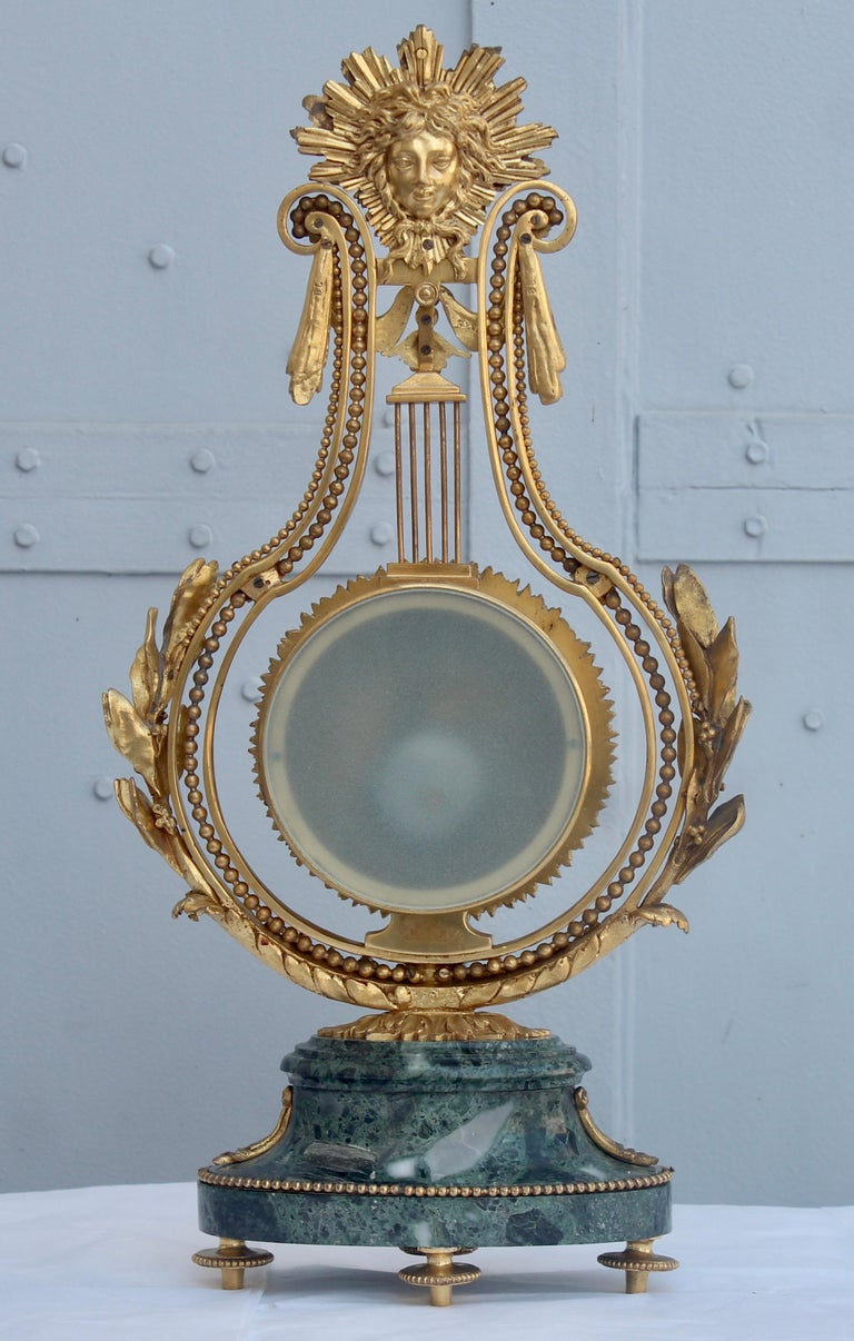 Late 19th Century 19th Century French Ormolu and Marble Three-Piece Lyre Shaped Clock Garniture For Sale