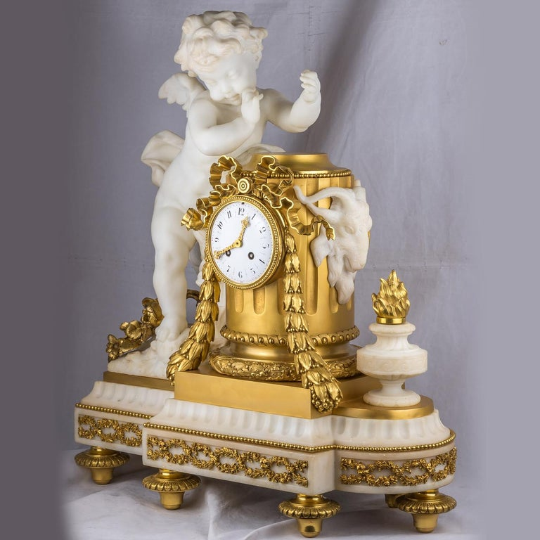 Exquisite Quality French Ormolu and White Marble Winged Cherub Clock.  Date: 19th century Origin: French Dimension: 25 1/2 in. high, 23 in. wide, 10 1/2 in. deep