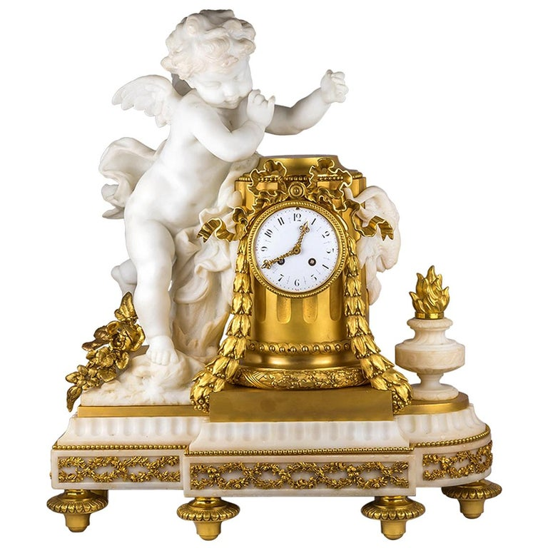 19th Century French Ormolu and White Marble Winged Cherub Clock For Sale