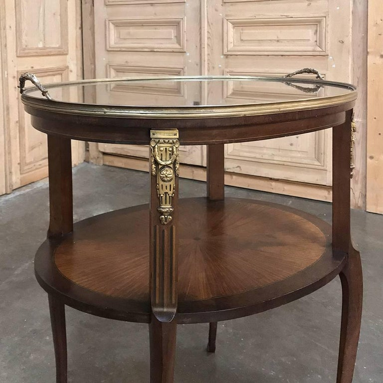 19th century French oval occasional  table with Marquetry and Ormolu and glass serving tray also makes a great choice as a coffee or tea serving table! Radial grain patterns were expertly installed on the tops, with inlaid border below and brass rim