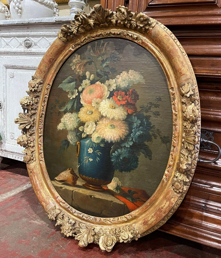 Invite color into your home with this elegant oil on board painting. Painted in France circa 1870 and set in a carved gilt frame, the colorful composition features a cobalt blue vase dressed with bronze handle and base, and filled with a floral
