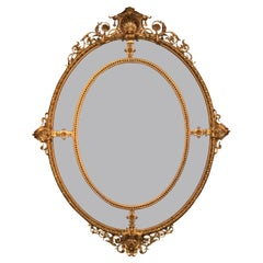 19th Century French Oval Shaped Antique Giltwood Wall Mirror