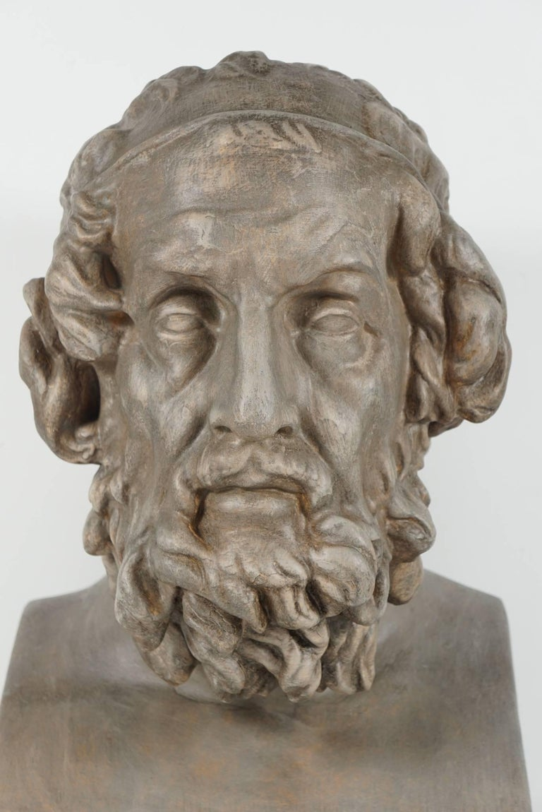 This bust in painted plaster is French and was made in the last quarter of the 19th century. The figure Homere the blind poet and philosopher is masterfully rendered with detail and character. Deeply modeled the face is contemplative. The hair and
