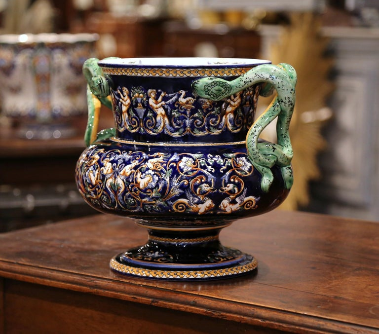 """This round and colorful antique planter was created in """"Faïencerie de Gien,"""