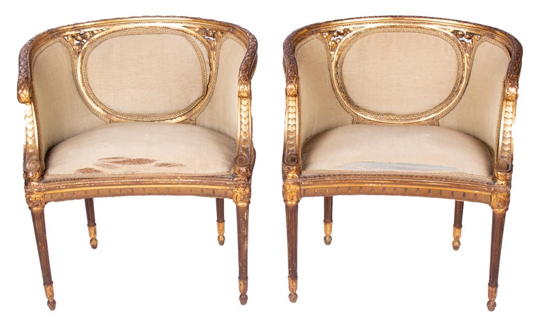 19th century French pair of gold gilded wooden armchairs.