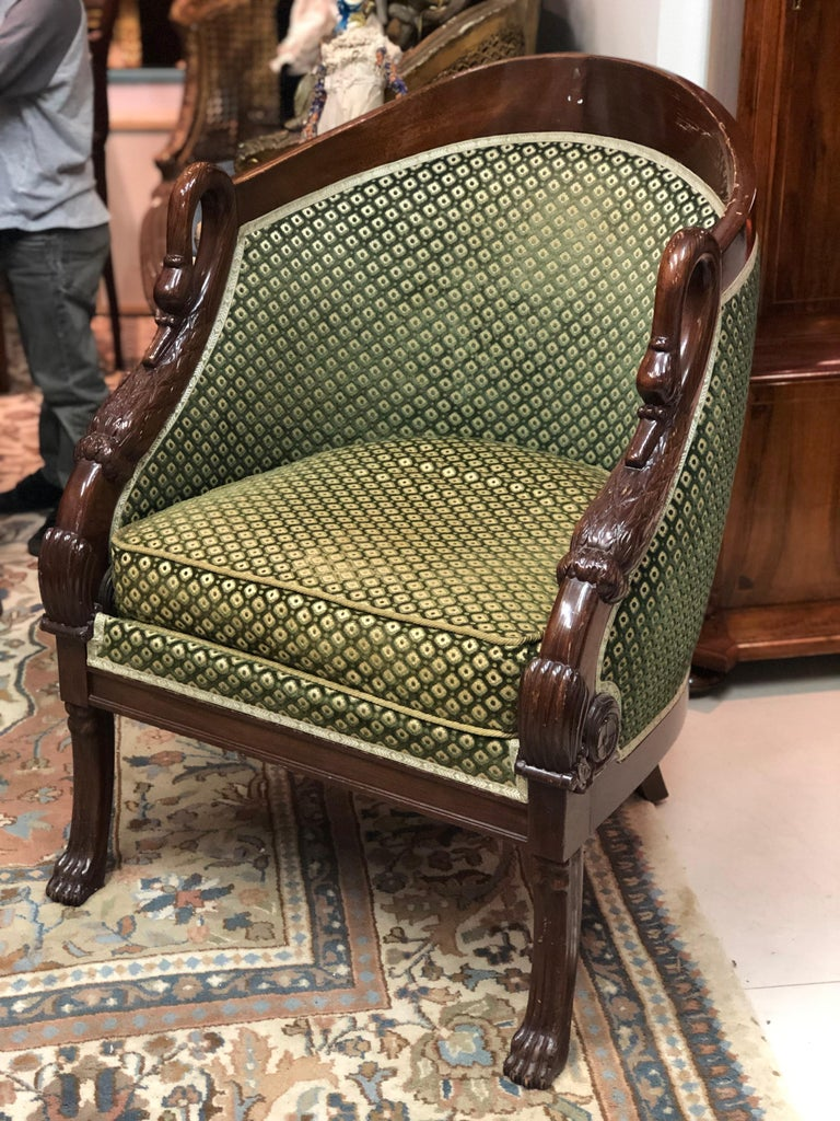 French pair of mahogany Empire style armchair with swan's headrests in green upholstery. Very good condition with no restorations. In our gallery we have also a single bed and a vanity table which match perfectly the armchairs as a style and as a