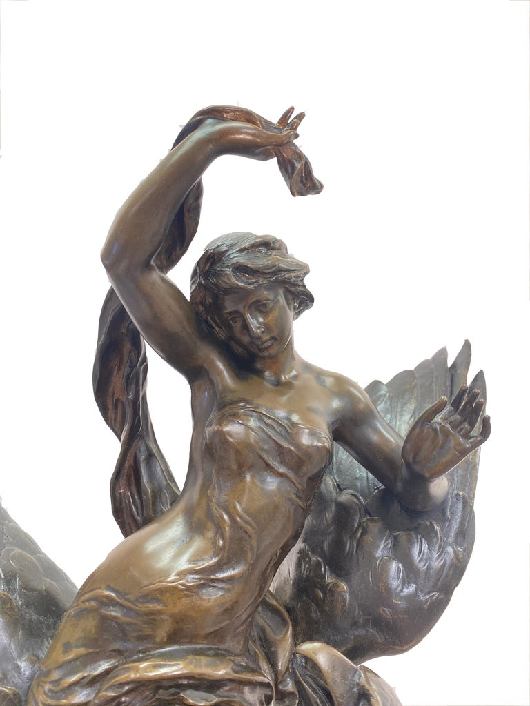A wonderful signed French bronze statue by artist CHARLES OCTAVE LÉVY 1820-1899 Nymph and eagle Patinated bronze sculpture on a quadrangular base in red marble. Measures: 65 x 38 x 30 cm.