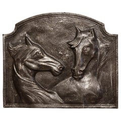 Mid-19th Century French Polished Iron Fireback with Horse Head Sculptures