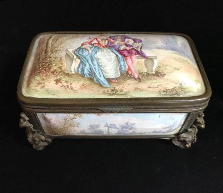 This is an exceptional, fine and impressive antique French enamel polychrome painted casket. Each panel of the box is painted in the 18th century manner with charming landscape motives. The hinged lid is decorated with a lovely, Fragonard inspired,