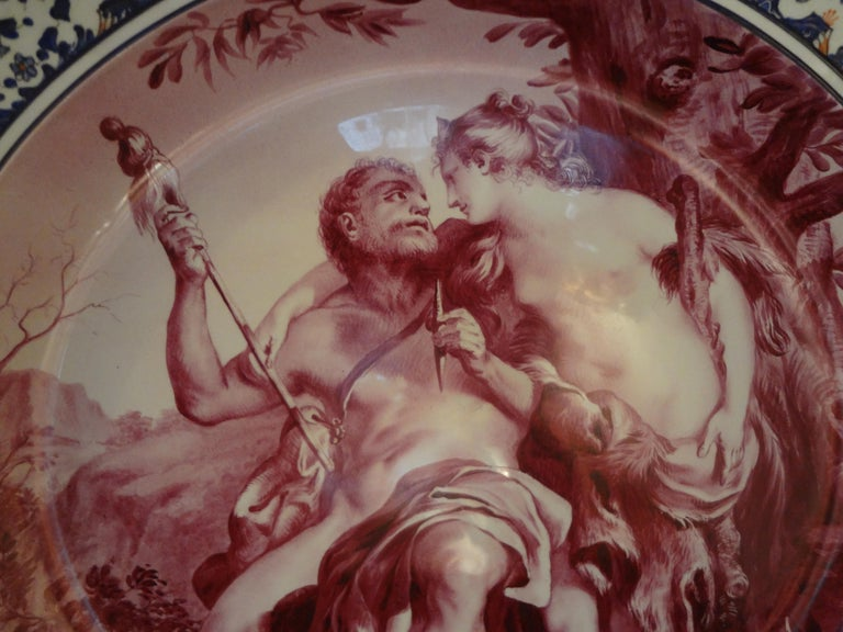 Stunning 19th century French hand decorated, artist-signed allegorical porcelain charger. This beautiful well executed charger depicting Hercules is executed in unusual burgundy and dark blue tones. Our French Napoleon III charger dates from