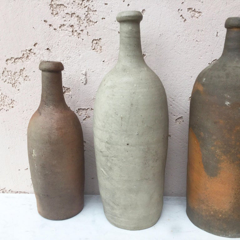 French pottery cider bottle from Normandy, end of 19th century. 13 bottles available, sold separately. Different sizes.