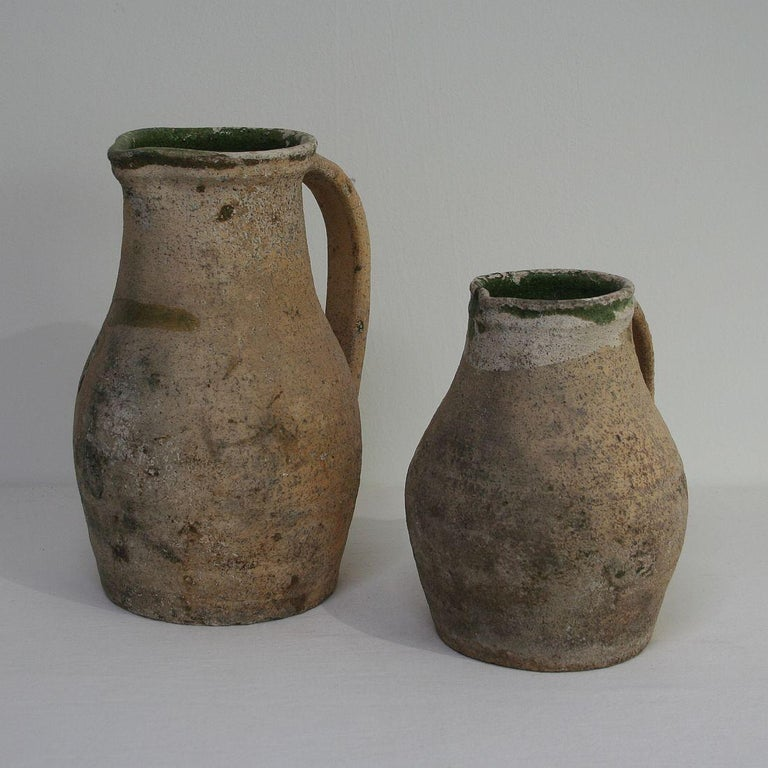 Pair of beautiful primitive earthenware pitchers, France, circa 1800-1850.