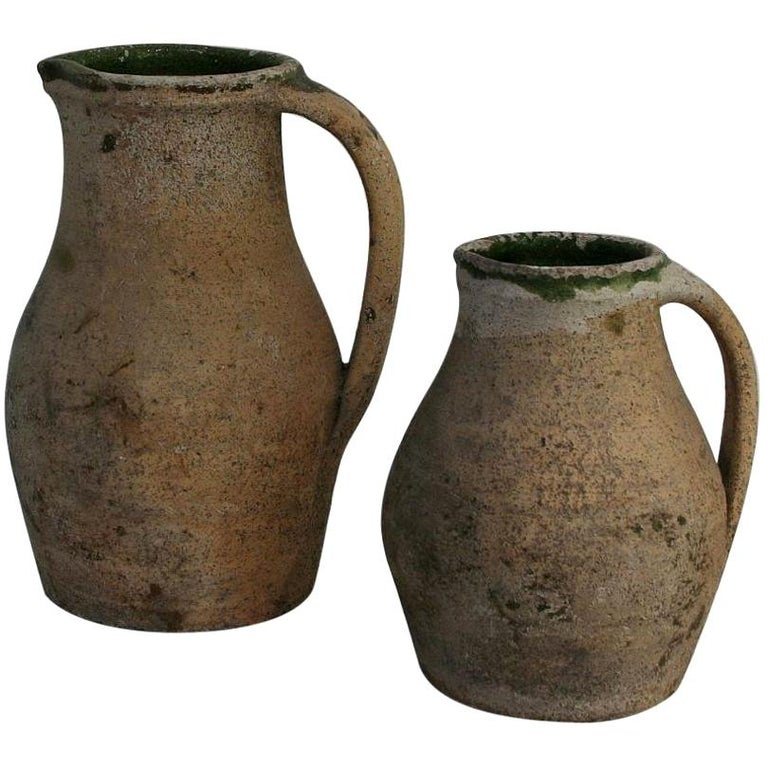 19th Century French Primitive Glazed Earthenware Pitchers For Sale