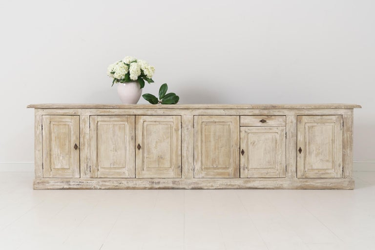 A 19th century French Louis Philippe enfilade found in Provence. This beautiful six-door and one drawer sideboard or buffet has been hand dry-scraped down to the original gesso, circa 1880. The shelves are 17 inches deep. This is a great piece with